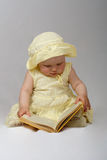 Little girl read a book Stock Photos