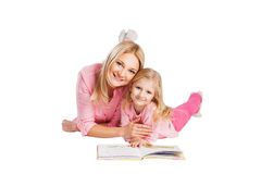 Little girl read book with mother Stock Images