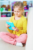 Little girl read book in tablet Stock Photography