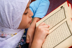 Little girl read holy Qoran Royalty Free Stock Images