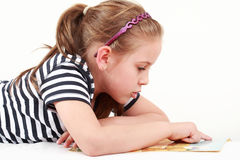 Little girl reading Stock Image