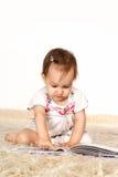 Little girl reading Stock Photography