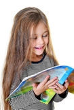 Little girl reading. Cute little girl reading a funny interesting book Royalty Free Stock Images