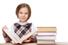 Little girl reading big book Royalty Free Stock Images