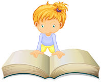 Little girl reading from big book Stock Image