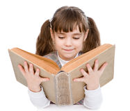 Little girl reading big book. isolated on white background Royalty Free Stock Image