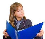 Little girl reading from a big folder Stock Photography