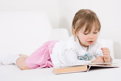 Little girl reading book Stock Images