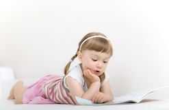 Little Girl Reading Book Stock Photos
