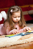 Little girl reading book. Sweet little girl reading book royalty free stock photos