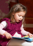 Little girl reading book Stock Image