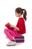 Little girl reading book Royalty Free Stock Images