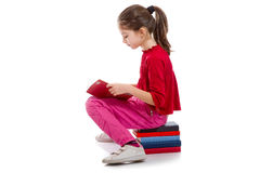 Little girl reading book Stock Photography