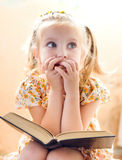 Little girl reading book Stock Photos