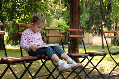 Little girl reading a book Royalty Free Stock Photo