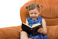 Little girl reading book. And have fun Stock Photos