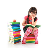 Little girl reading the book Royalty Free Stock Photography