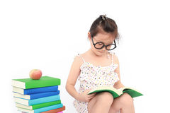 Little girl reading the book Stock Photography