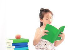 Little girl reading the book Stock Image
