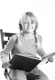Little girl reading book Royalty Free Stock Photos