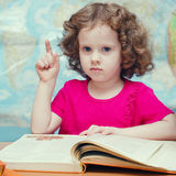 Little girl reading a book Royalty Free Stock Photography