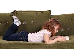 Little girl reading book Stock Images