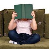 Little girl reading book Royalty Free Stock Photos