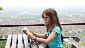Little girl reading stock video
