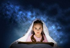 Little girl reading book in bed royalty free illustration