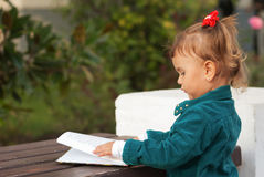 Little girl reading a book. Royalty Free Stock Photos