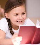 Little girl is reading a book. Cute little girl is reading a book Stock Photography