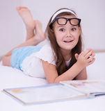 Little girl is reading a book. Cute little girl is reading a book Royalty Free Stock Photos