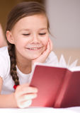 Little girl is reading a book. Cute little girl is reading a book Royalty Free Stock Image