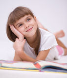 Little girl is reading a book. Cute little girl is reading a book Stock Images