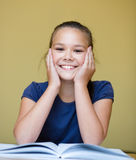 Little girl is reading a book Royalty Free Stock Photos