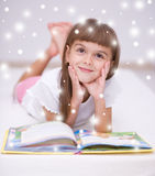 Little girl is reading a book Royalty Free Stock Photography