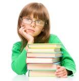 Little girl is reading a book Stock Photos