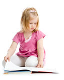 Little girl reading book on floor isolated Royalty Free Stock Photography