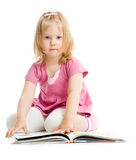Little girl reading book on floor isolated Royalty Free Stock Photo