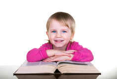 Little girl reading the book Royalty Free Stock Photo