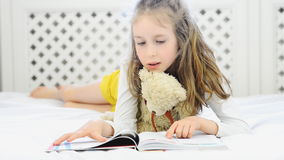Little girl reading. stock video footage