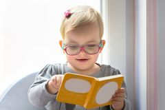 Little girl reading book. At home Royalty Free Stock Image