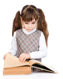 Little girl reading book. isolated on white background.  stock photos