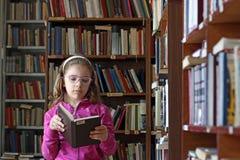 Little girl reading a book Stock Photos