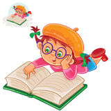Little girl is reading a book lying on her stomach Royalty Free Stock Photography
