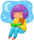 Bedtime story. Little girl reading a book at night Stock Photography