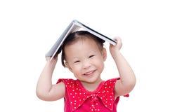 Little girl reading book over white Stock Images