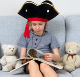 Little girl reading book. Stock Photo
