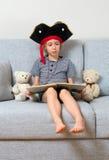 Little girl reading book. Stock Photo