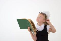 Little girl reading book, preparing for school Stock Photography